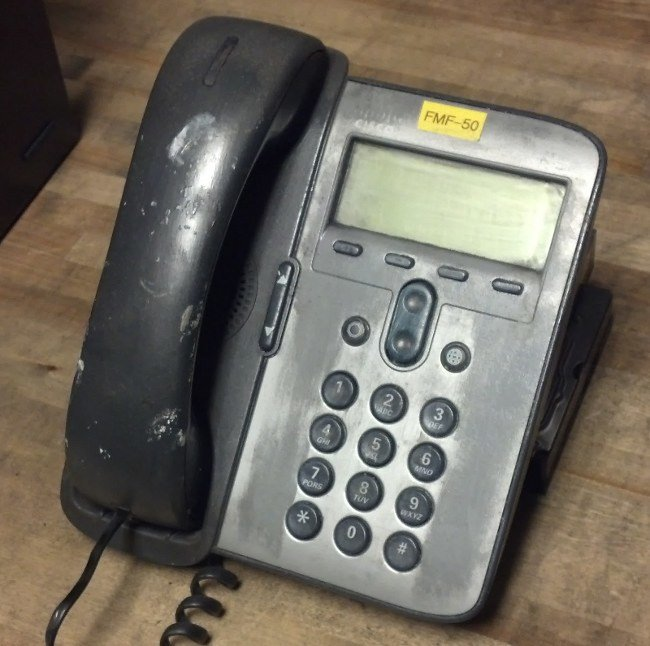 An acetone-destroyed Cisco 7911 IP Phone